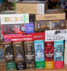 Revoltech haul. (tfangel) Tags: alien woody stack pile boxes predator haul evangelion robotech yotsuba danbo revoltech figma