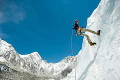Practising for Everest (Alex Treadway) Tags: nepal terrain woman mountains ice expedition nature girl sport wall female outdoors photography high dangerous asia hiking awesome extreme scenic rocky peak bluesky trying glacier adventure equipment explore climbing summit environment balance nepalese ropes copyspace climber grip majestic eastern khumbu everest abseiling crevasse challenge himalayas mountaineer highaltitude basecamp attempting steady lowering descending crampons precarious icefall abseil treacherous everestbasecamp khumbuglacier solukhumbu colourimage everestrange 2030years