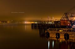 Foggy Wharf (coffeeandbeer80) Tags: ocean light sea water fog night portland harbor pier boat still crane maine foggy calm wharf late barge pilling unionwharf d7000
