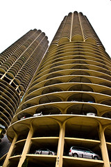 Towering (RichardDemingPhotography) Tags: windows people urban chicago cars glass canon reflections availablelight lakeview canoneos lincolnpark downtownchicago fastcars chicagoillinois roscos canonlglass tacksharp northhalstead canoncameras streetsofchicago apocalypsedecadence canon1dmarkiv canonworldwide