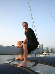 Sitting on the Boom (David J. Greer) Tags: sail sailing water ocean false creek vancouver bc boom boy male feet sunglasses outdoor outdoors outside barefoot