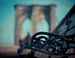 benching on brooklyn bridge (happy bench monday) (pamela ross) Tags: world bridge shadow sun newyork tourism pen bench 50mm minolta f14 famous bank olympus brooklynbridge ep1 texturebokeh