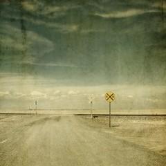RR (jssteak) Tags: road sky clouds canon square tracks rr dirtroad plains grasslands textured railroadcrossing newmexio texturesquared t1i