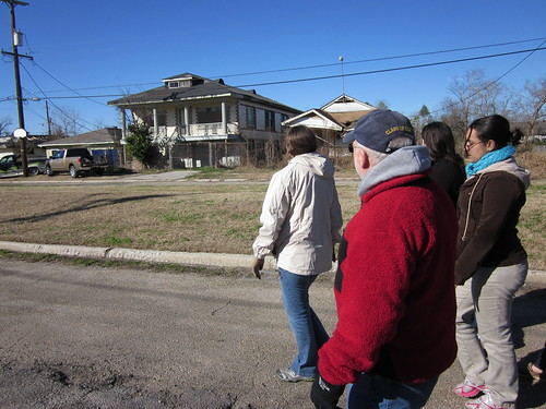 Professor of Chemistry Larry Eng-Wilmot leads students on a walking tour of the Lower 9th Ward