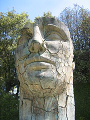 Cracked face statue with eyes closed (amazing_tina) Tags: trees statue lookingup eyesclosed crackedface unusualstatue