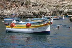 Blue Grotto boats, Malta (Andrew_Simpson) Tags: sea cliff water rock landscape boats boat rocks mediterranean hill malta cliffs hills caves cave mediterraneansea zurrieq zurrieqmalta urrieq bluegrottomalta bluegrottocavesmalta bluegrottocaves blurgrotto