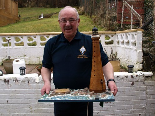 Former keeper Ian Duff, of Oban, with a model of Skerryvore that he built while stationed there.