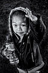 Greeting Hmong Toddler, Laos (t.coyner) Tags: boy blackwhite toddler asia seasia child laos hilltribe hmog