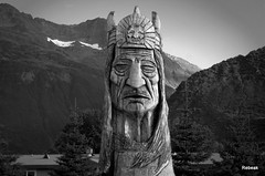 Native American (Rebeak) Tags: wood trees sky blackandwhite bw white snow black building art nature alaska landscape nikon prayer textures valdez mountians recent headdress treecarving nikond40 nativeprayer picasa3 rebeak americannatine