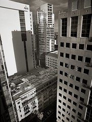 monoverticality (mugley) Tags: city trees windows urban blackandwhite bw slr cars mamiya film rooftop monochrome skyline architecture modern clouds buildings mediumformat reflections prime high 645 cityscape glare shadows skyscrapers kodak towers perspective australia melbourne wideangle victoria scan d76 negative epson cbd tall 6x45 residential offices mamiya645 urbanlandscape plusx awb 125px v700 keystoning mamiya645protl m645 republictower kodakplusx125 australianwheatboard nondakatsalidis 35mmf35sekorn willsst 414latrobe empireapartments