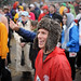 Rain-soaked participants enjoy Krispy Kreme Challenge festivities.