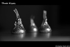 Three Kisses (skippys1229) Tags: blackandwhite bw home monochrome canon candy artistic florida chocolate kisses depthoffield hersheys wrappers tinfoil ocala hersheyskisses marioncounty depthoffocus ocalafl 18135mmlens ocalaflorida 3kisses threekisses t1i canonrebelt1i