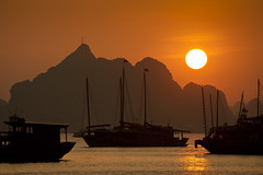 """Rising Sun"" Vietnam (Dan Ballard Photography) Tags: world pictures light sunset vacation sky favorite mountain mountains color art dan nature water beautiful beauty docks sunrise landscape boats photography bay boat blog amazing nikon asia flickr heaven photographer photos pics outdoor great dramatic best vietnam tricks burning photographs photograph workshop tips stunning ballard lesson portfolio pick teach touristattraction halongbay dreamscape catbaisland photograpy sunstar veitnam nohdr nothdr outdoorphotographer outstandinshots d700 danballard danballardphotography danballardphotogarphy"