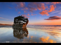Final Resting Place (pdxsafariguy) Tags: ocean sunset reflection beach clouds oregon coast sand rust pacific shipwreck wreck fortstevens peteriredale tomschwabel iredale