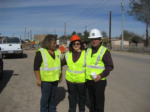 Yuma County Public Works Specialist Rachel Stallworth is flanked by Rosemary Felix, USDA Rural Development Loan Specialist and Leonard Gradillas, Community Programs Program Director during a recent visit to Avenue B&C Colonia outside of Yuma, Arizona.
