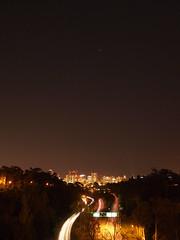 the bridge (roofusjohnson) Tags: california city trees light sky night stars lights long exposure downtown sandiego time olympus noflash freeway sirius canismajor balboapark 163 1442mm epl1