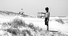 solitaire at the beach (Maria Chanourdie) Tags: boy sea portrait people bw mer byn blancoynegro praia beach uruguay mar sand mare gente areia retrato playa arena chico plage spiaggia puntadeleste