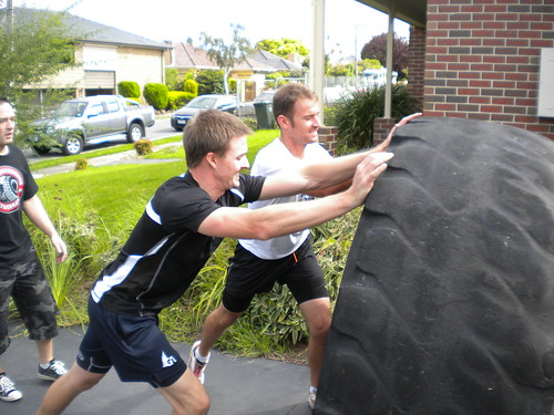 Mark & Will flipping a 320kg tyre (side view)