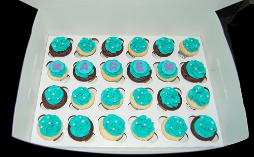 50 turquoise and purple mini cupcakes for a 50th birthday celebratrion