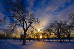 Is spring here yet? (leakylightbucket) Tags: trees sunset sky sun snow canon evening day minnehaha hiawatha 40d sigma1020mmf35 regionwide