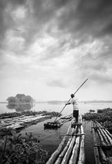 Bamboo Rafter, Waduk Cengklik, Solo (syukaery) Tags: people blackandwhite bw lake tourism water vertical indonesia landscape mono pond nikon wideangle bamboo tokina solo raft humaninterest surakarta d90 centraljava 1116mm wadukcengklik