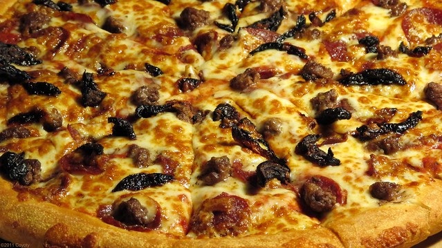 Pepperoni, beef, and sun-dried tomato pizza