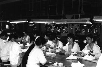workers making Keds sneakers