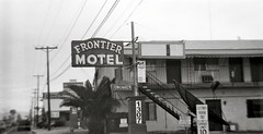 Mesa on film - Frontier hotel (kevin dooley) Tags: arizona bw favorite white film analog 35mm wow photography hotel photo back interesting fantastic lomo lomography flickr image very good awesome picture free award superior az pic super monotone best more most diana photograph creativecommons winner excellent much 3200 incredible better ilford mesa frontier exciting winning blck stockphotography phenomenal frontierhotel freeforuse