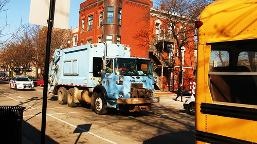 A City of Chicago department of Streets and sanitation garbage truck heading eastbound on West Taylor Street. Chicago Illinois USA. Wednsday, March 16th, 2011. by Eddie from Chicago