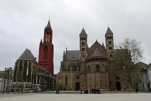 Basilica next to church with red tower