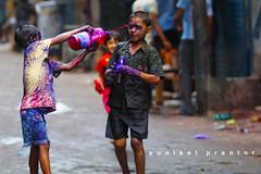 holi (auniket prantor) Tags: old boy color eye face festival festive asian religious holli asia indian south full colored dhaka festivity hindu holi liquid enjoying bangladesh bazar portriat throughing flickrduel shakhari