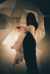 (howlingatmoons) Tags: shadow film dark sinister umbrellas disposable