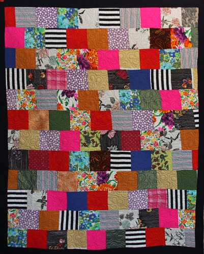 This quilt was made using recycled and vintage fabrics.