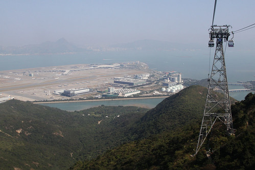 Rising to the top of Lantau Island, Hong Kong airport down below