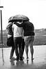 Safety First, Then Teamwork. (Idalianie Flores Photography) Tags: school girls boy bw white black flores umbrella canon eos rebel 50mm j f14 rainy ely irene usm gonzalez patricia ida ef georgie guzman teamwork lucero isales t1i idalianie