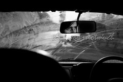 Eyes wide open (knowsnotmuch) Tags: car sunshine 35mm mirror driver rearview hyderabad dirtywindshield