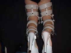 White Bail Locked KAFO (KAFOmaker) Tags: white leather fetish high highheel sandals leg bondage thigh strap heel ankle calf bound brace sandal restraints restraint restrained orthopedic cuffed strapped braced buckled tightly legbrace kneepad