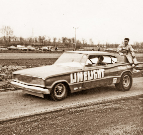 Limelight Dodge funny car on the return road at Detroit Dragway