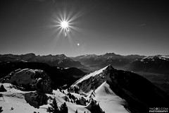 Swiss panorama with sunflare (yago1.com) Tags: winter sun white snow black mountains sol canon landscape schweiz switzerland soleil berge landschaft sonne 2011 sunstars myswitzerland yago1