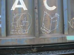 whistle_1_10_new_years_destitution_book_j_easley (httpill) Tags: streetart art train skull graffiti streak tag graf railcar boxcar buzzard railways freight readmore booker bookman oye whistleblower readmorebooks moniker coaltrain thereader hobotag hobomoniker benching johneasley skullwings freighttraingraffiti boanes thelonesomewhistle httpill