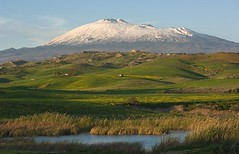 The majestic Etna dominates the green hills of the hinterland of Sicily.