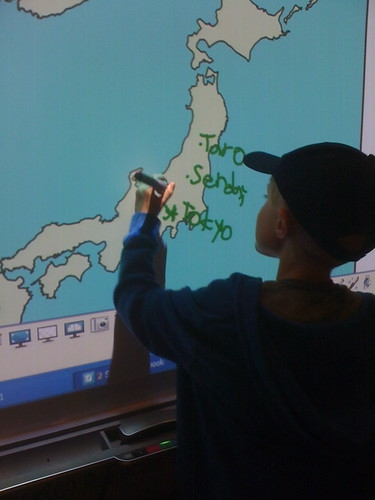 The author 's son labeling places in Japan on an interactive white board