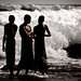 Three monks against the white sea.