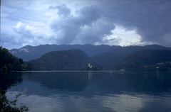 Bled (Cthonus) Tags: lake church geotagged boat slidefilm slovenia scanned analogue slovenija lakebled julianalps blejskiotok bledisland churchoftheassumption pletna republikaslovenija cerkevmarijinegavnebovzetja blejskojezero julijskealpe pilgrimagechurchoftheassumptionofmary