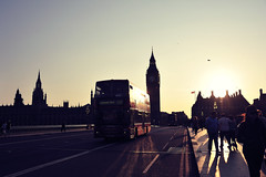 Over the Bridge ([~Bryan~]) Tags: city uk travel bridge light sunset red people urban bus london silhouette europe unitedkingdom bigben westminister londonbus westministerbridge