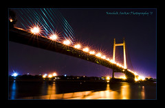 Second Hooghly Bridge, Kolkata, India. (Koushik Sarkar) Tags: city travel blue sunset sky india tourism architecture night river evening nikon colours indian places nightsky kolkata bengal calcutta bangla ganga cpl ganges ghats bengali westbengal howrahbridge d60 babughat 2ndhooghlybridge cplw