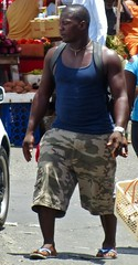 Prowler alert (Legin_2009) Tags: road street food man black male men guy walking market walk african sandals stall guys cargo camouflage flipflops males caribbean shorts slippers mec mecs cargoshorts braghettoni