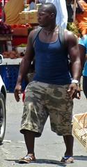 Prowler alert (Legin_2009) Tags: road street food man black male men guy walking market walk african sandals stall guys cargo camouflage flipflops males caribbean shorts slippers mec mecs cargoshorts braghettoni