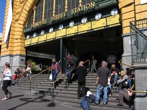 Steps of Flinders Street, covered with people bumming around as per usual
