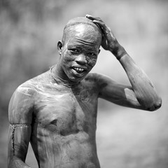 Body decoration before Donga fight in Surma tribe - Ethiopia (Eric Lafforgue) Tags: africa people blackandwhite horizontal de outside outdoors person la fighter artistic ornament l warrior omovalley bodypainting ethiopia hairstyle rite personne humanbeing headdress adornment coiffure pigments headwear headgear dehors hairdress nomade omo eastafrica abyssinia vallee 1513 combattant exterieur waistup guerrier vueexterieure nomadicpeople alataille etrehumain tulgit peoplesuri valleedelomo regardantlobjectif peoplesoftheomovalley cadragealataille peoplepeuple suripeuple omopeoples valleypeuple surmaclayargilepeinture corporellesagenaicombat batonstick surmasuritributribesurma batonssaginaycontemplationnakednessnuditenudenunakeddecorativedecoratifdecorationornementtogethernessensembletogethervirilityvirilitepieds fightingdongarituelritualcombattantsfightersguerrierswarriorscombat nusbarefootpeuples